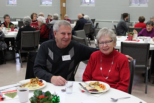 An older man and woman enjoying a holiday meal together